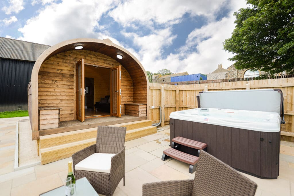 An open glamping pod with a private hot tub