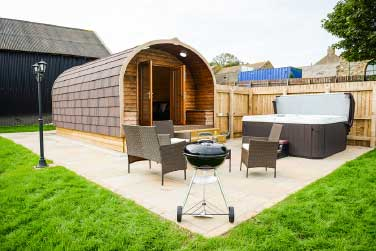 Glamping pod with hot tub and barbecue